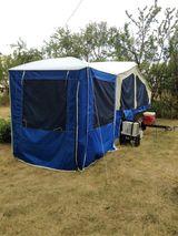 Pop up tent trailer.
